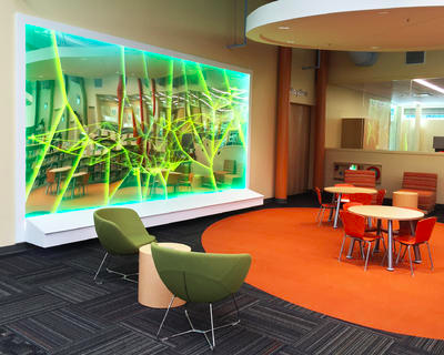 Bright green, yellow and teal lights go across a screen in a web-type form.