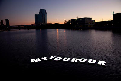 Image of larger body of water at sunset with white text that reads myyourour