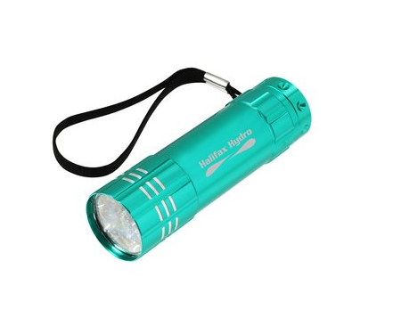 teal compact flashlight on white background