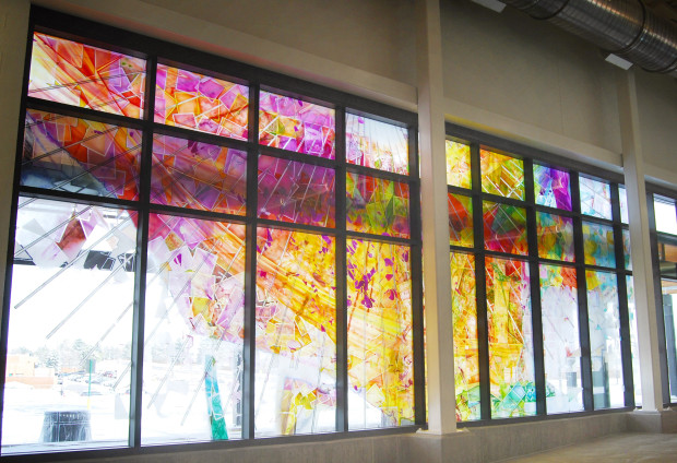 stained glass window of various colors of public art in central rec center in aurora