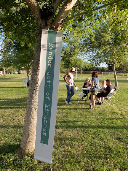 Picture in the park with text for random acts of kindness.