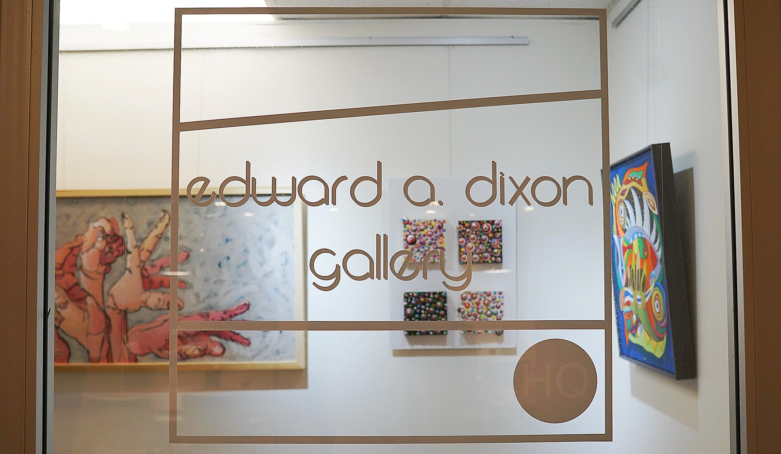Image of the window of the Edward A Dixong Gallery. Their logo displays showing the gallery name