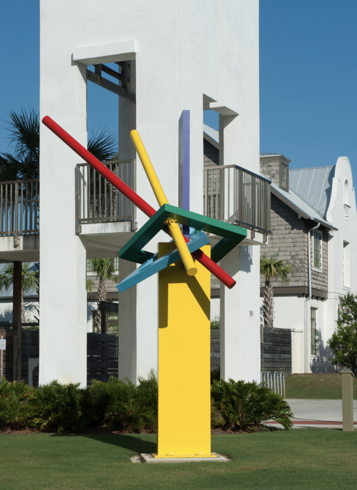 A yellow beam with yellow, red, and blue poles coming from the center.