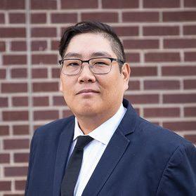 headshot of Ken Cho